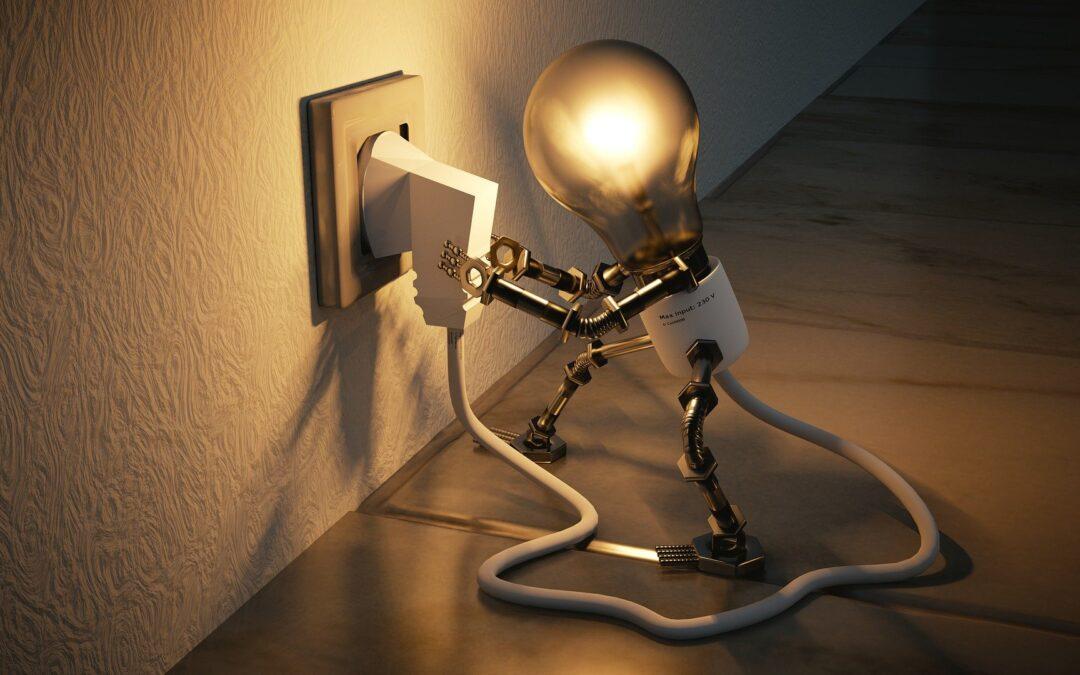 una lampadina stacca la presa per ottenere un risparmio